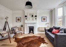 Living-room-with-oversized-floor-lamp-cowhide-rug-and-midcentury-chairs-217x155