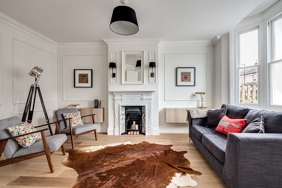 Living room with oversized floor lamp, cowhide rug and midcentury chairs [Design: JLB Property Developments]
