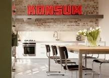 Make a statement with illuminated signs in the industrial kitchen! [Design: Eilmann Architekt]