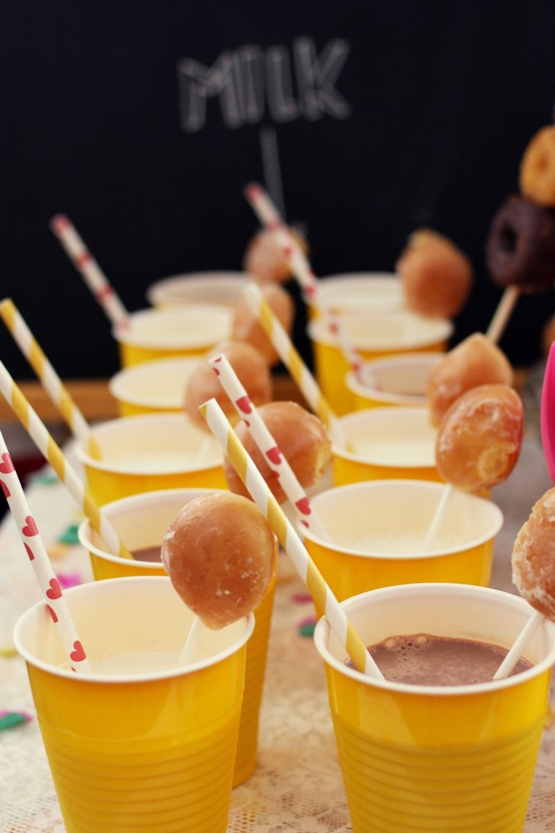 Milk with donut stirrers from A Beautiful Mess