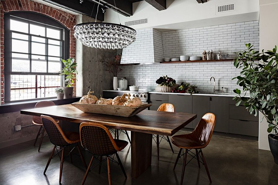 Modern chandelier brings glam to the industrial setting [Design: Jessica Helgerson Interior Design]