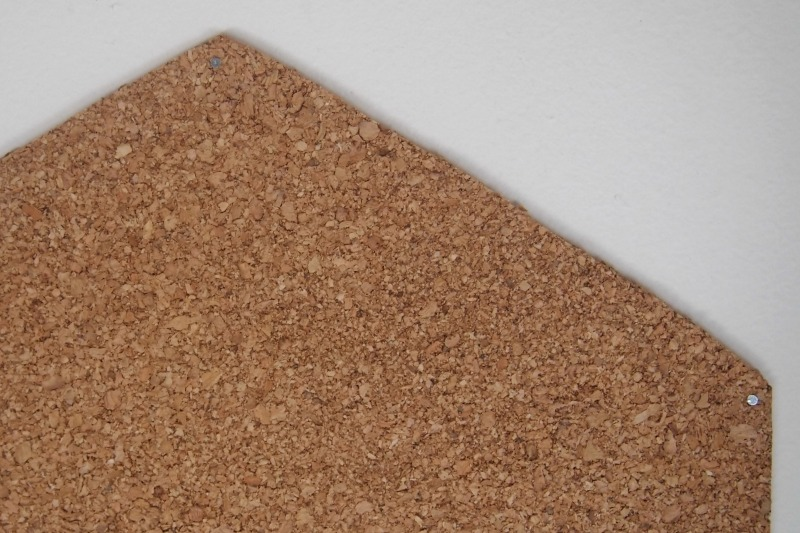 Nail all corners of cork-board onto wall