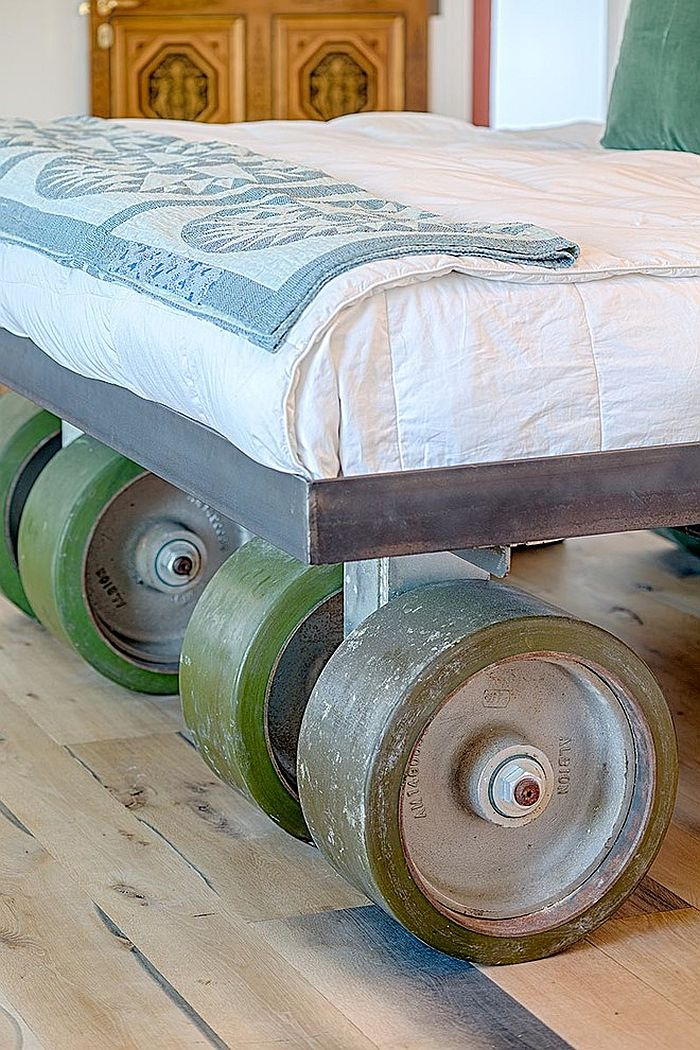 One-of-a-kind bed on wheels brings rustic elements to the contemporary home
