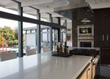 Open and airy kitchen design with stylish glass walls