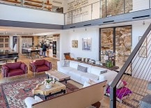 Open-plan-living-area-crafted-in-metal-and-glass-217x155