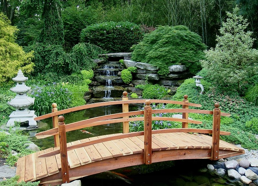 Opt for a bridge that blends in with the landscape and elevates the ambiance [Design: Redwood Garden Bridges]