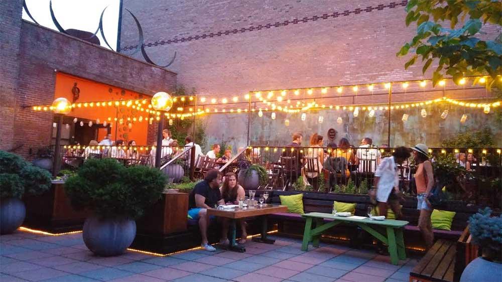 Outdoor Restaurant with String Lights - Decoist