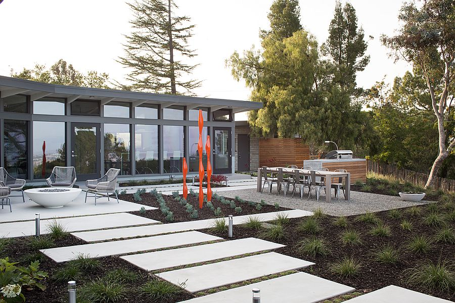 Outdoor dining, sitting area and barbeque space of the contemporary home