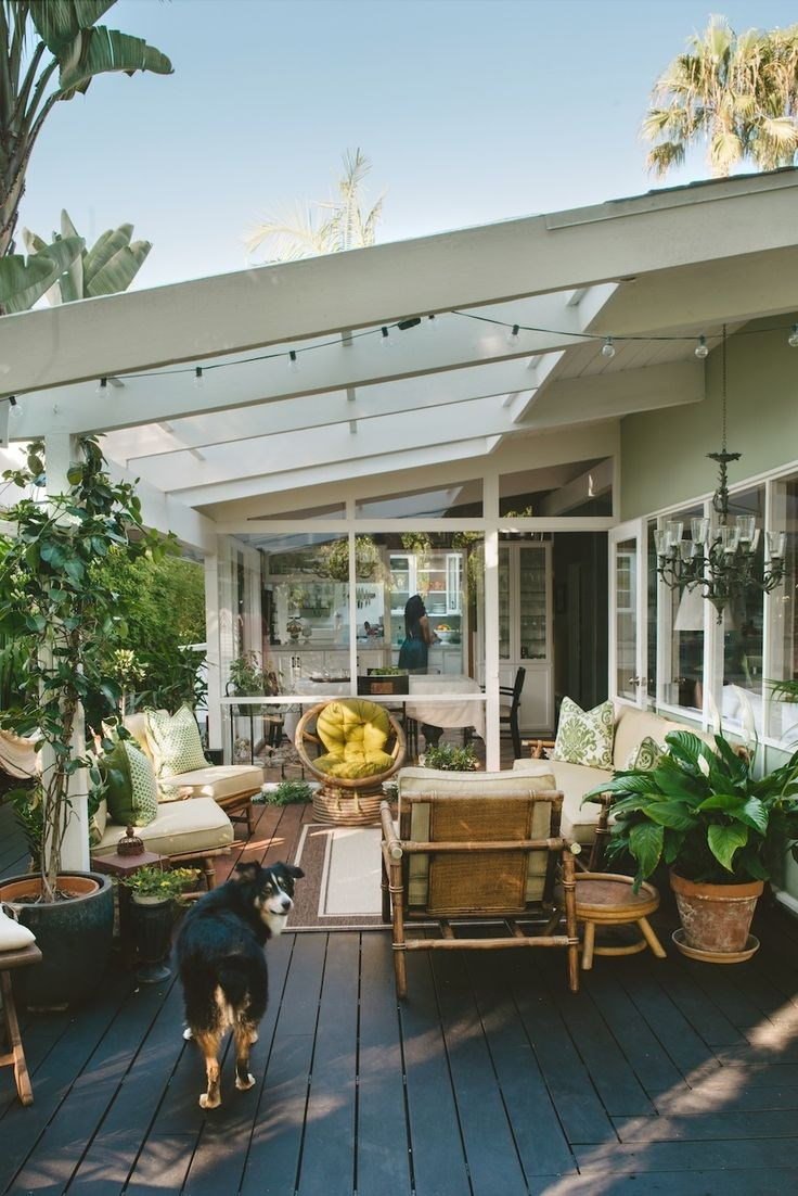 Outdoor lounge area with potted plants