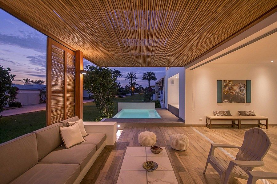 Outdoor lounge of the home offers an unabated view of the distant sea
