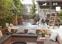 Outdoor sunken lounge surrounded by natural greenery and vintage decor