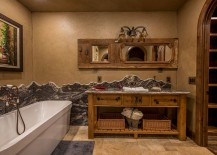 Plastered walls bring rustic magic to the charming bathroom
