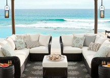 Pottery Barn black wicker sofa near ocean