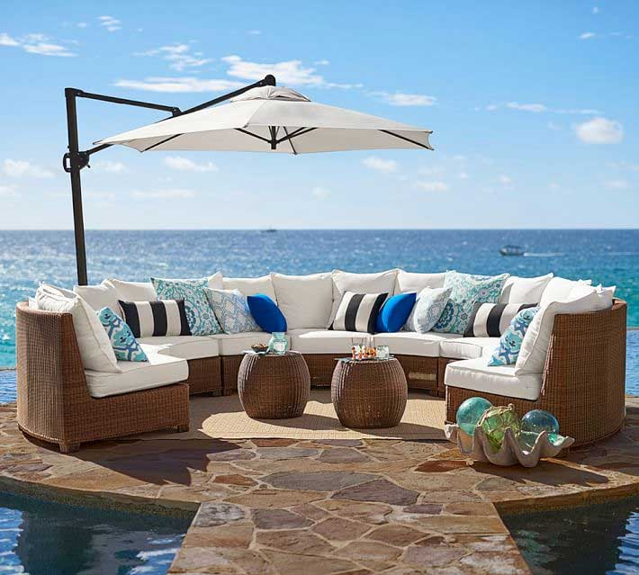 Pottery Barn honey wicker sectional next to ocean