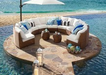 Pottery-Barn-honey-wicker-sectional-on-rounded-platform-next-to-ocean-217x155