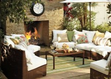 Pottery-Barn-honey-wicker-sectional-with-green-rug-near-fireplace-217x155