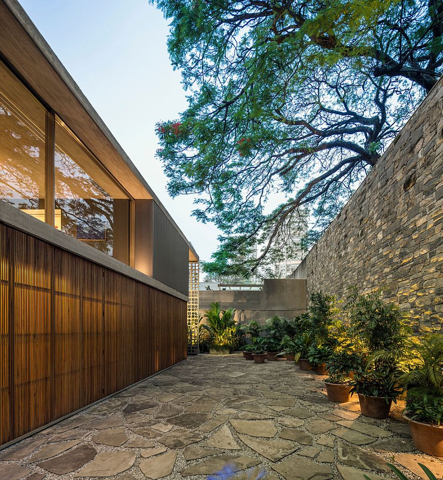Private backyard of the B+B House with stone finish