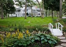Private-garden-with-a-small-stream-bridge-and-plenty-of-greenery-217x155
