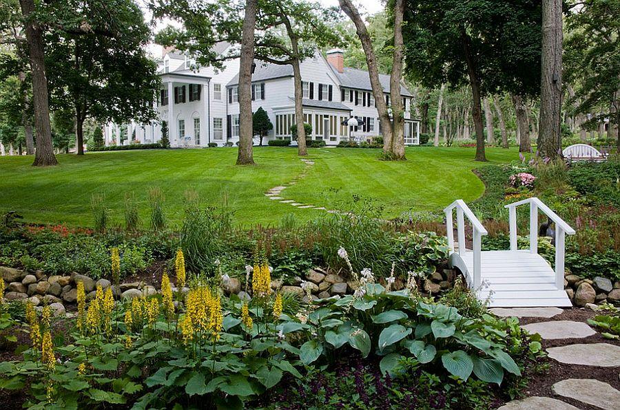 Private garden with a small stream, bridge and plenty of greenery [Design: Van Zelst]