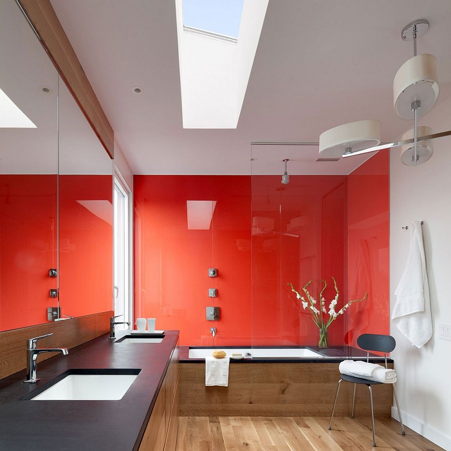 Red and black give the contemporary bathroom with skylight a dazzling appeal