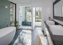 Relaxing-spa-styled-master-bathroom-in-white-with-a-cool-accent-wall-217x155