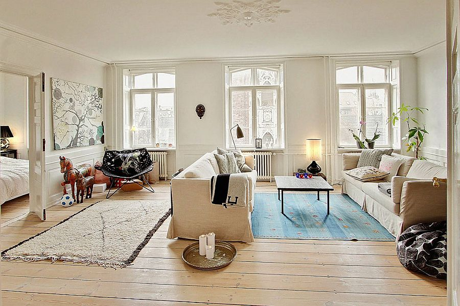 Rug adds a hint of blue to the living room A Study in Scandinavian Style: Charming Modern Apartment in Denmark