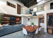 Rugged-chic pendant lights blend in with the contemporary loft style