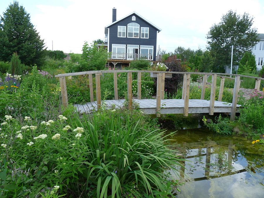 Rustic landscape around cottage with a cool garden bridge