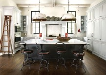 Salvaged DIY pendant lights add to the industrial vibe of the kitchen