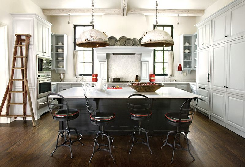 Salvaged DIY pendant lights add to the industrial vibe of the kitchen [From: ROMA]