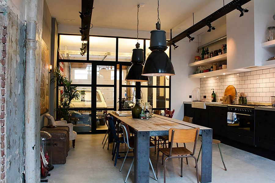 Simple and spacious industrial kitchen design with black pendants that stand out visually [Design: Bricks Amsterdam / Photo: Louise de Miranda]