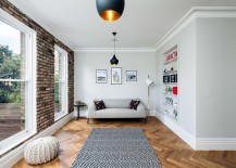 Small living room with brick wall and Tom Dixon pendants 217x155 50 Chic Scandinavian Living Rooms That Steal the Show!
