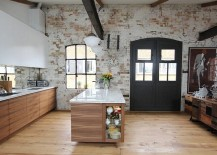 Smart industrial kitchen with a brick wall backdrop [Design: Increation Interior Design]