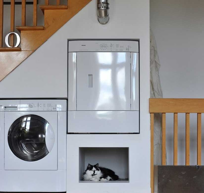 Space Saving Laundry and Pet Bed Area in Montreal