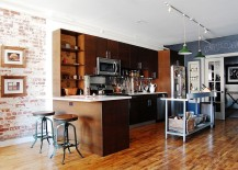 Spacious-kitchen-with-elegant-use-of-wood-for-cabinets-and-island-217x155