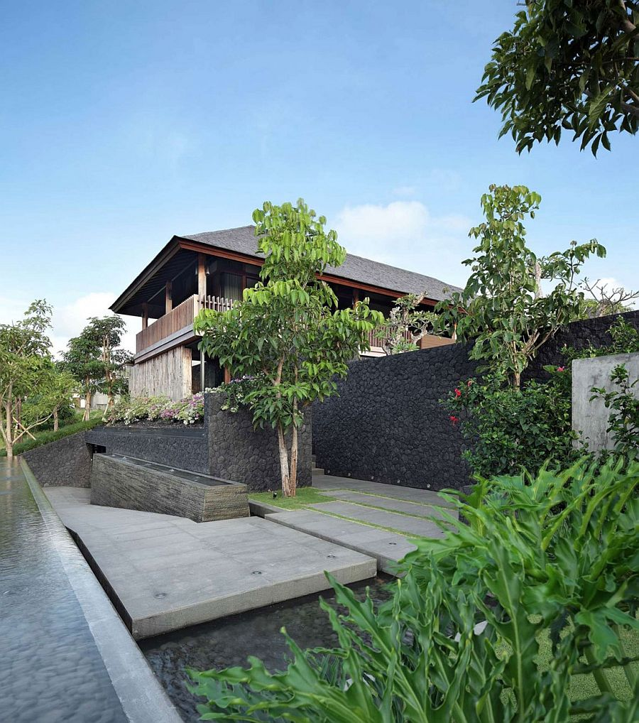 Stone and wood shape the elegant home in Bali with sea views