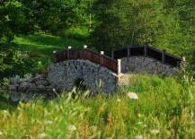 Stone-bridge-above-a-natural-creek-for-the-rustic-retreat-217x155