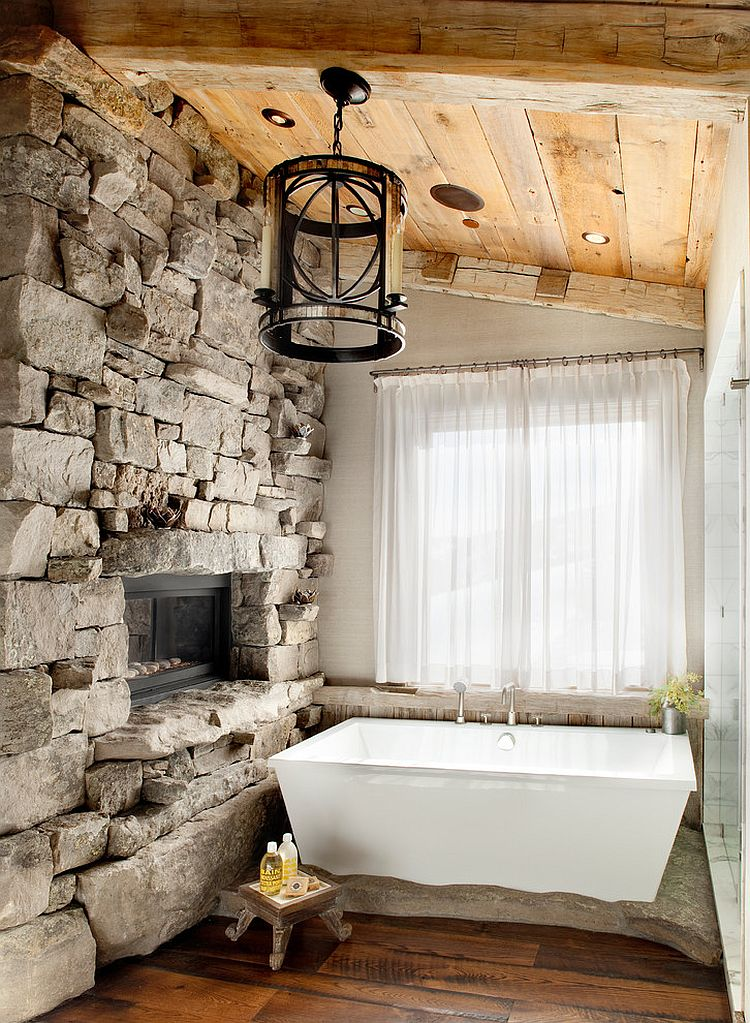 Stone wall brings the charm of a ski lodge design home