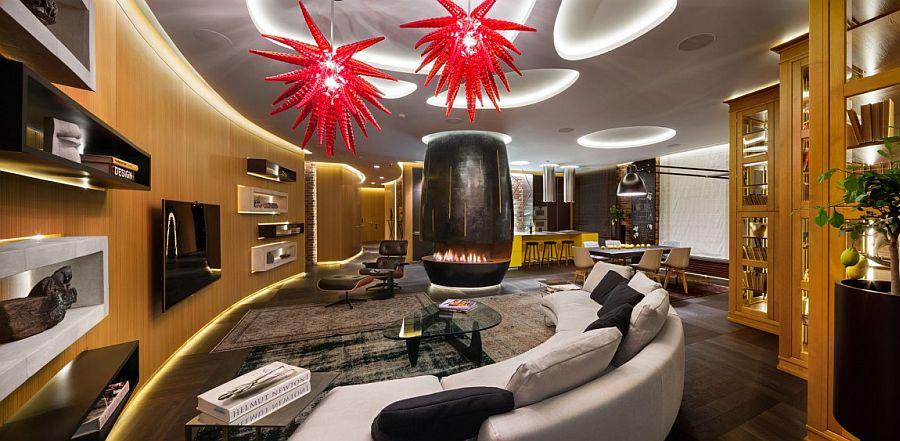 Stunning living room with bright red pendants and a gorgeous fireplace at its heart