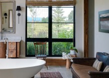 Subtle touches such as the wood pedestal for the bathtub usher in the rustic vibe [Design: Snake River Interiors]