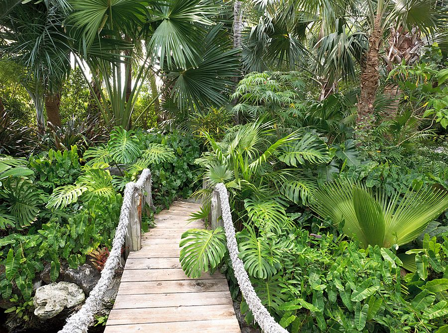 Suspension-style bridge with rope is perfect for that fabulous tropical backyard [Design: Raymond Jungles]