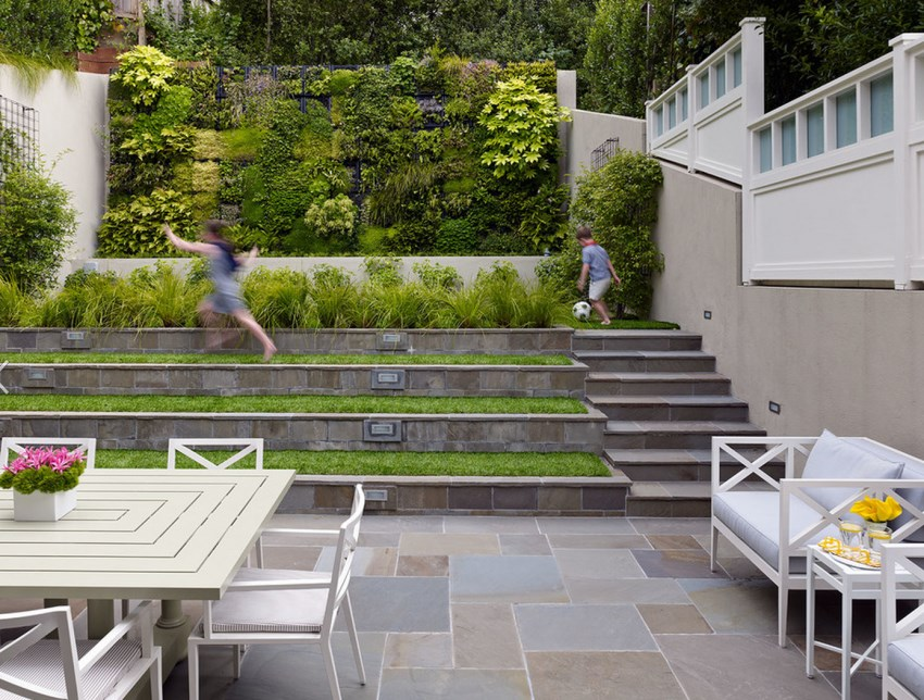 Terraced backyard with a vertical garden