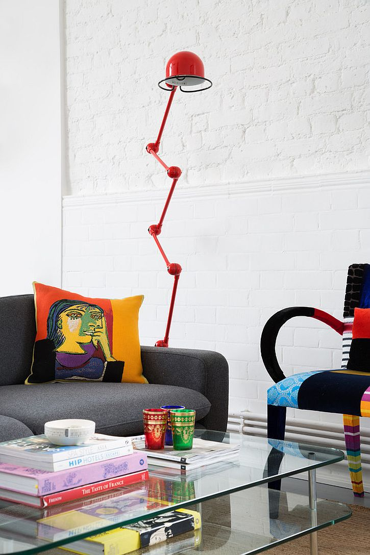 Throw pillows and decor bring color and playfulness to the living room [Design: Trunk Creative]