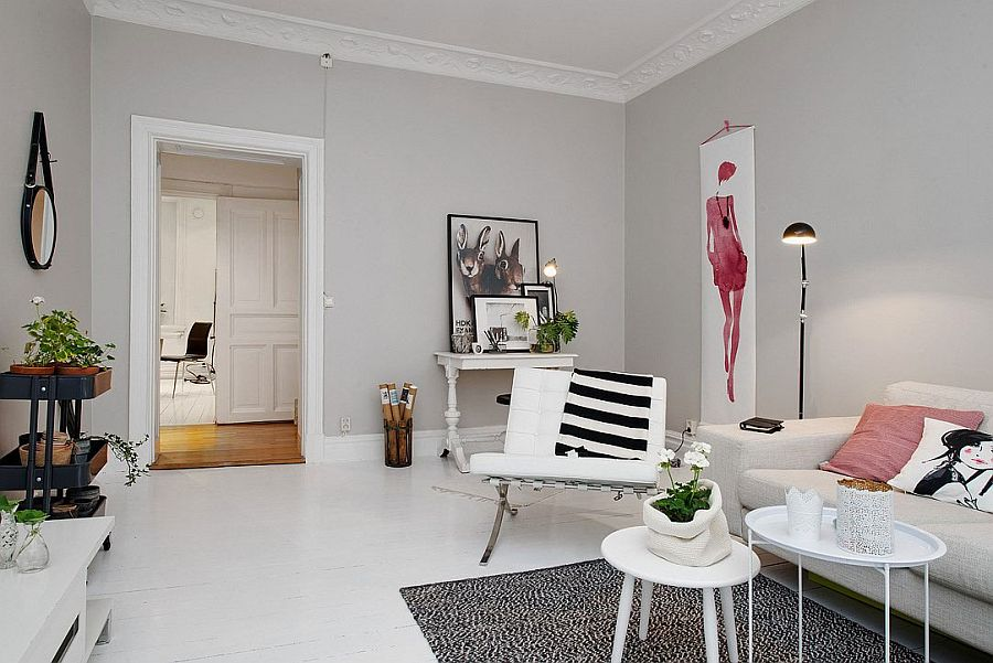 Throw pillows and wall art add a touch of feminity to the room