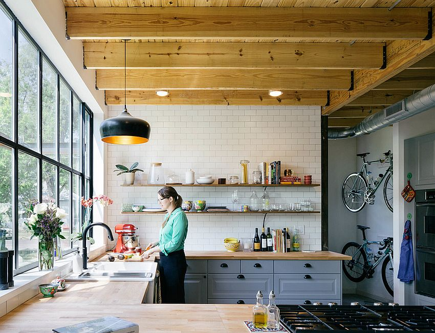 Tile and wood meet inside this lovely industrial kitchen