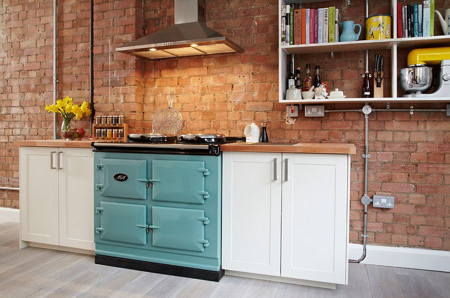 Tiny kitchen with a brick wall backdrop and open shelf [Design: Propia Limited]