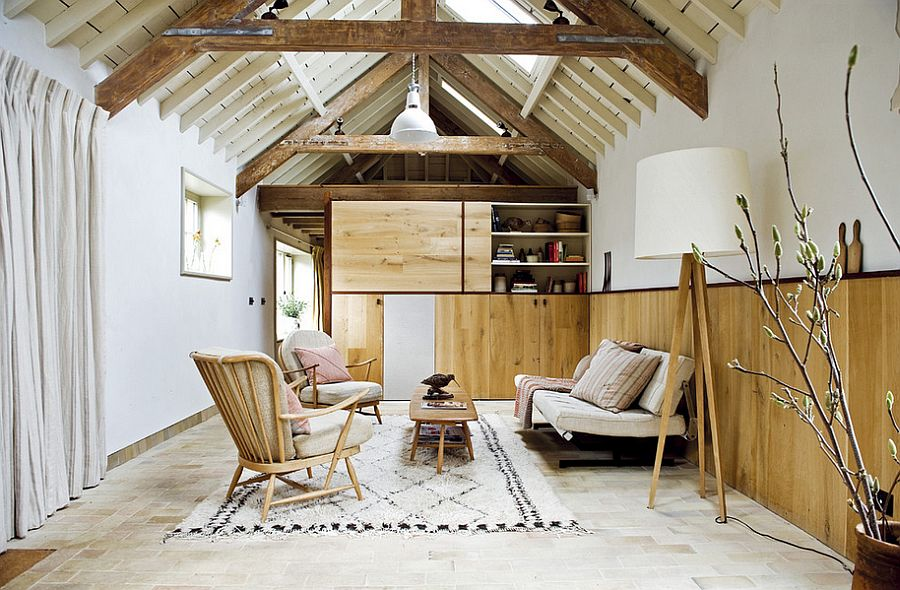 Tranquil living room with warm reclaimed wood wall [Design: Retrouvius Ryland Peters & Small]