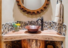 Tree trunk turned into a unique vanity for the small bathroom [Design: By Design Interiors]