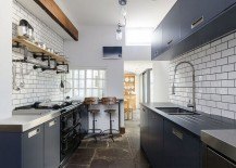 Trendy gray cabinets inside the narrow kitchen [Design: Moon Design + Build]
