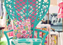 Turquoise peacock chair with vibrant cushions